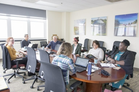 committee members sit around conference table at iSEE
