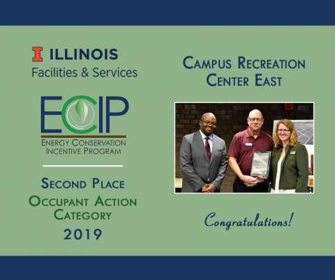 ECIP winners from Campus Rec Center East accept their award plaque