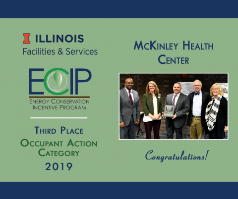 ECIP winners from McKinley Health Center accept their award plaque